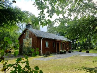 Secluded woodland cottage on the banks of a pristine Highland river