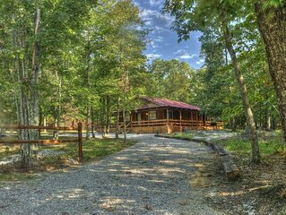 Red Cabin - Sleeps 4. Wrap around porch. Large family room and kitchen.