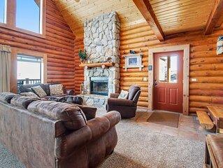 Beautiful log cabin w/ lake views, wraparound deck, & foosball for the kids!