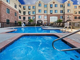 Awesome Location! Equipped Suite Near Six Flags with Gym + Free Breakfast!