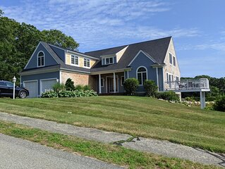 Spacious 4BR Cape home with water views.