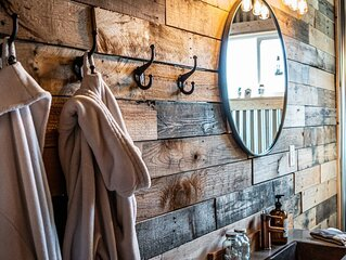 Charming and cozy converted shed filled with worldly treasures and warm touches.