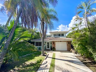 Beautiful Beach House with pool, lush tropical landscaping steps from the ocean.