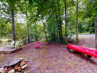 Dog-friendly, waterfront cabin w/ a private hot tub, wraparound decks, & dock!