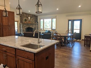 Beautiful home, stunning 40 acre Yak farm with creek meandering through valley