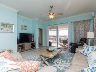 Flawless 5th floor corner unit with beautiful lake and partial ocean views!!