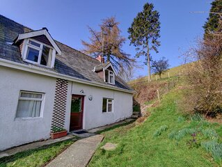 Six miles from the town of Builth Wells, Cae'r Mynach Cottage is a cosy semi-det