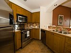 Clean and Fully Equipped Kitchen Comes with Granite Counters and Stainless Steel Appliances
