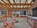 Expansive Lanai with massive wood burning fireplace, BBQ and dining area.