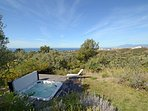 The jacuzzi commands an amazing rustic view over a golf course to distant Gibraltar