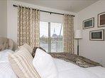 Queen bed with full master bathroom en suite