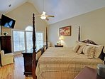 The Angel Room has a king size bed, high vaulted ceiling, & full height windows.