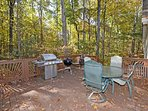 The main deck is a very private area surrounded by the house and thick woods.
