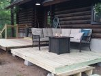 Deck with sitting area and propane fire table