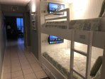 Bunk beds have their own personal TV featuring Netflix.