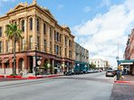Enjoy an afternoon of shopping and great food in the historic Strand District.