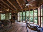 350+ square foot deck on connected to rear of home.  Stack stone fireplace, ceiling fans, hammock