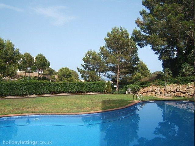 28. Apartamento en planta baja con piscina, location de vacances à L'Almadrava