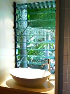 Ensuite Bathroom in Main House overlooking Tropical Garden