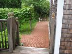Brick walkway behind the cottage.