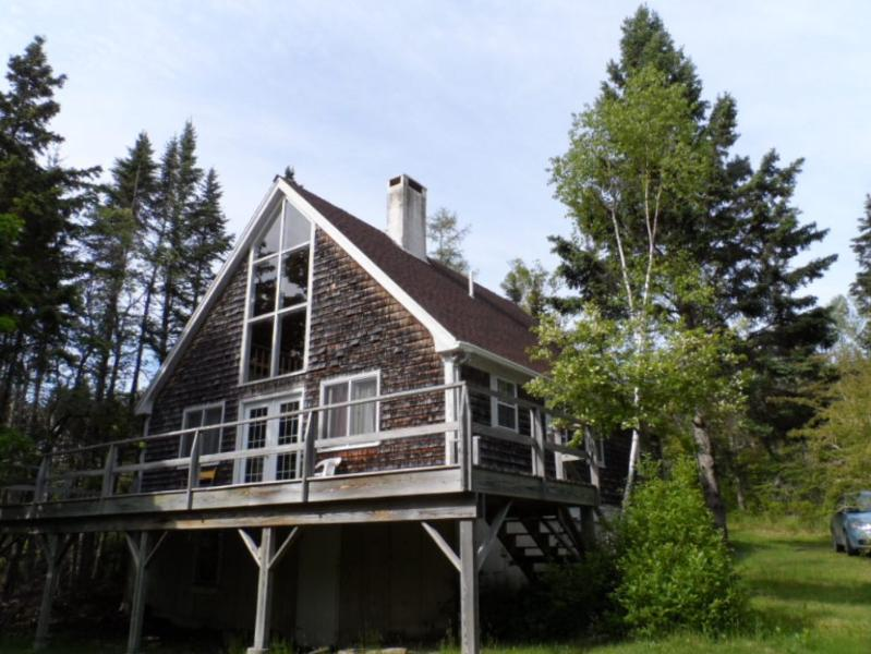 Front of cottage, nestled in the trees.