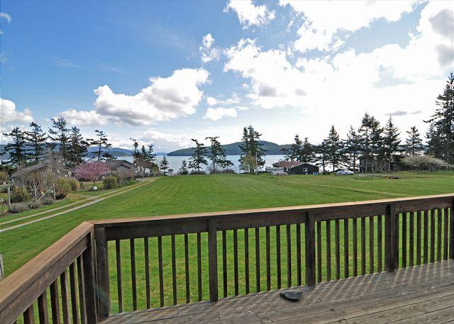 What a spot for croquet and badminton! Trail to the left leads to the beach.