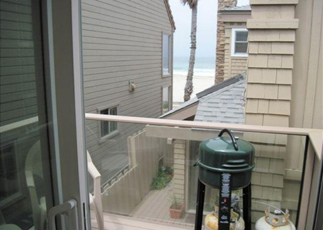 Newer patio with sliding glass door allows you to get a breeze right off the ocean, and a nice place to drink coffee.