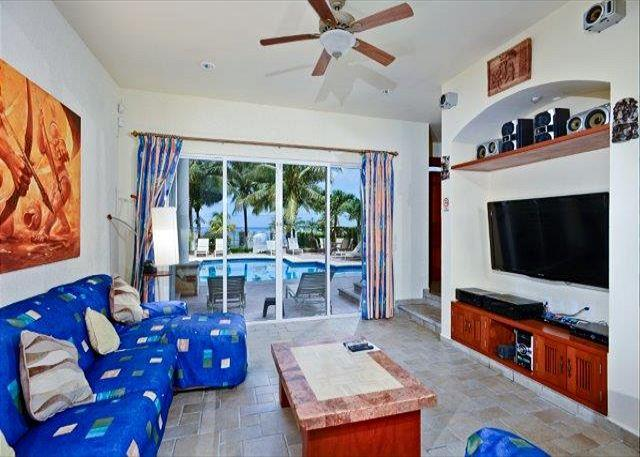 Spacious Ocean and Pool View Living Area with Flat Screen TV