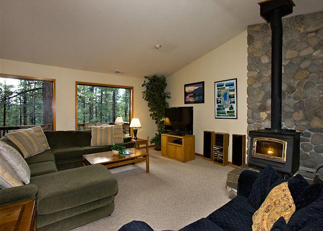 Large windows, vaulted ceilings, and a wood burning stove for co