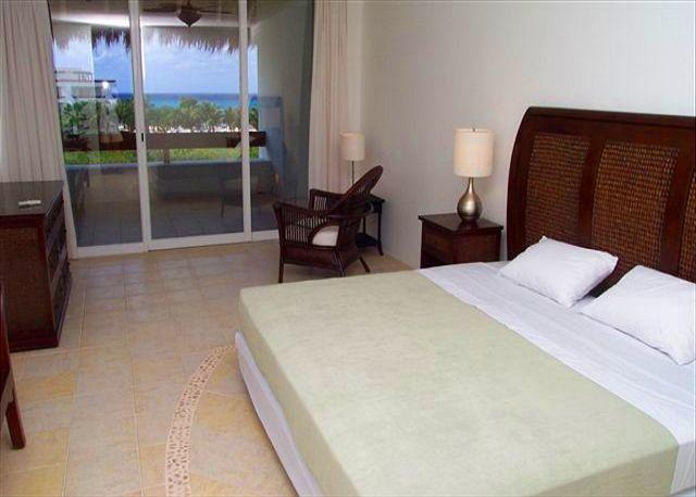 Oceanview Master bedroom with king bed and private bath