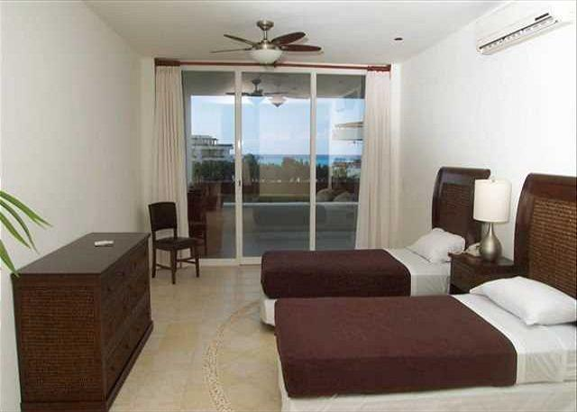 Bedroom 2 also has oceanview and two twin beds with private bath