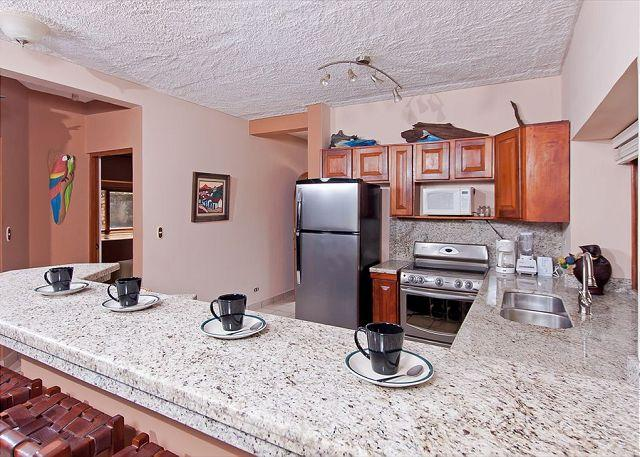 Kitchen with granite and stainless appliances