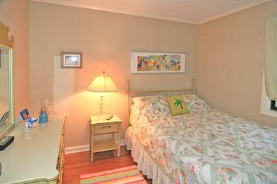 Bedroom has a queen bed
