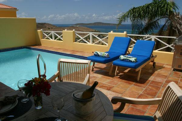 Relax on your private deck with pool and views.