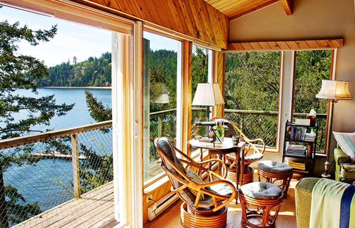 Double doors open to sea air, decks, mountain views, and the summer dock is 1 minute down the trail