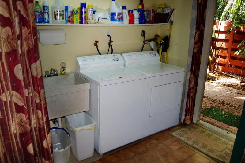 The washer, dryer and utility sink are in the garage with all the beach toys!
