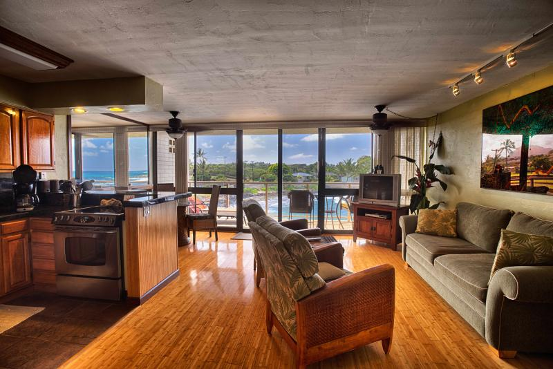 Aloha, welcome to our oceanfront Kauai condo vacation retreat with the beautiful wall of windows.