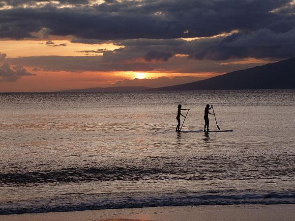 Paddlers at sunset from our beach