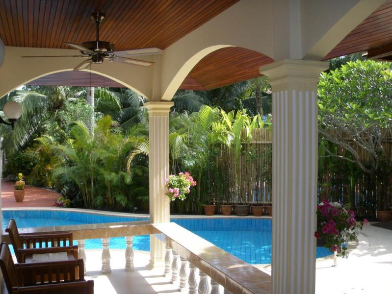 Relax on the Shaded Terrace Next to the Pool