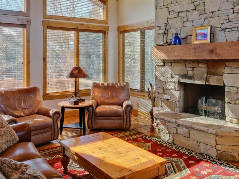 Spacious and Sunny Living Room Boasts, Vaulted Ceilings, a Flat-Screen TV, and Gas Fireplace