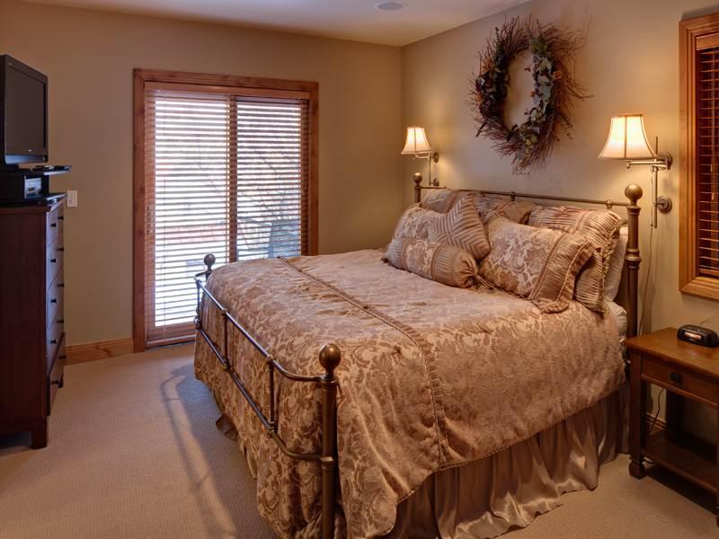 Master Bedroom Boasts a King Bed, Flat-Screen TV, and Private Bath
