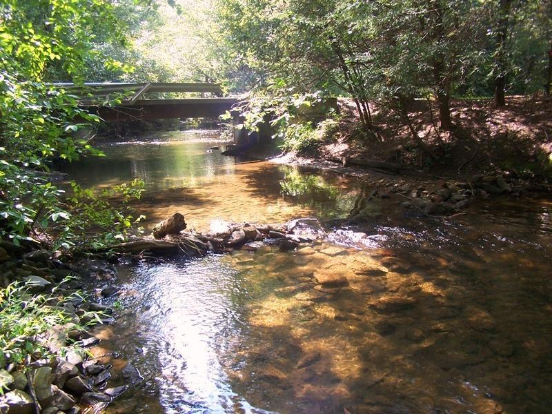 The Benton MacKaye Trail travels along the stream at the foot of the mountain