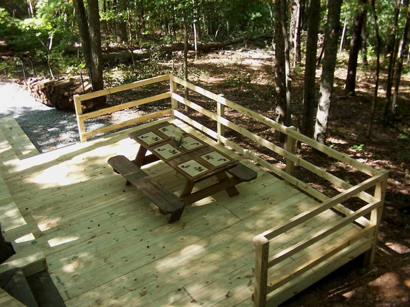 Enjoy the NEW deck with picnic table for family fun!
