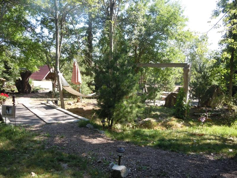 walkway from the hoblet, over the bridge to parking, pasture and more gardens