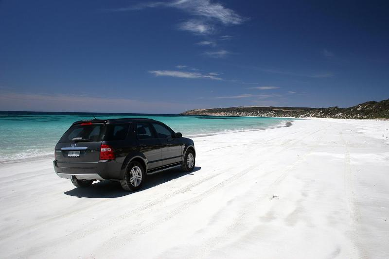 Emu Bay Beach, this beautiful 4km long white sandy beach offers safe swimming in turquoise clear water.