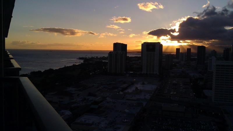 Sunset Partial Ocean /City / Mtn views from our private lanai on the TOP FLOOR at Ala Moana Hotel!