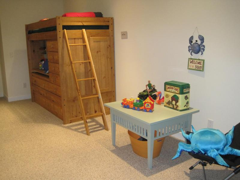 The playroom on the second floor includes a bunk bed, play area, flat screen tv, and video games.