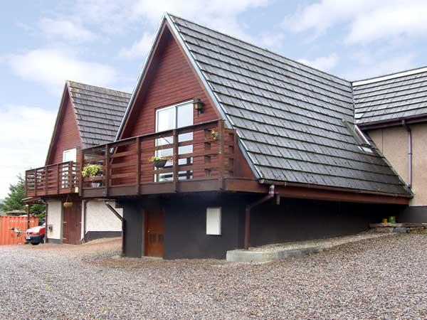 LARCHFIELD CHALET 2, pet friendly, country holiday cottage, with a garden in, holiday rental in Ross and Cromarty
