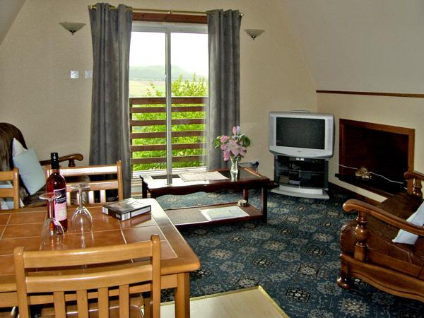 LARCHFIELD CHALET 1, pet friendly, country holiday cottage, with a garden in, holiday rental in Strathpeffer