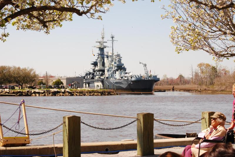 Battleship NC in Wilmington, 25 minutes north.  Kids of all ages love to climb all over the ship!